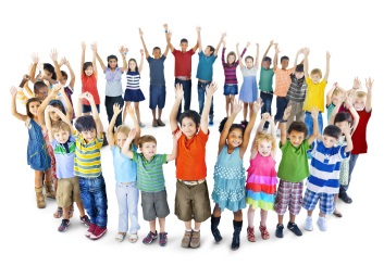 Group of kids in a circle-raising arms